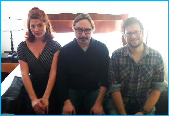 John Hodgman with hosts Vanessa Ragland and Cole Stratton